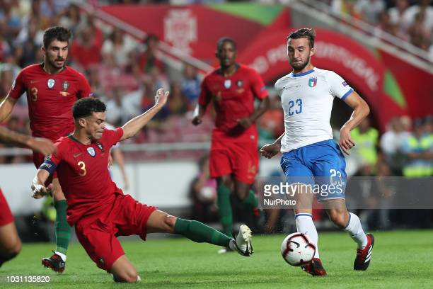 Italy's midfielder Bryan Cristante vies with Portugal's defender Pepe during the UEFA Nations League A group 3 football match Portugal vs Italy at...