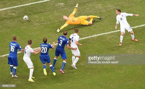 Italy's midfielder Claudio Marchisio scores during a Group D football match between England and Italy at the Amazonia Arena in Manaus during the 2014...