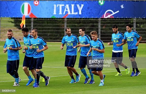 Italy's midfielder Daniele De Rossi Italy's goalkeeper Gianluigi BuffonItaly's defender Leonardo Bonucci Italy's defender Giorgio Chiellini Italy's...