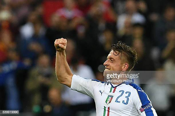 Italy's midfielder Emanuele Giaccherini celebrates after scoring during the Euro 2016 group E football match between Belgium and Italy at the Parc...