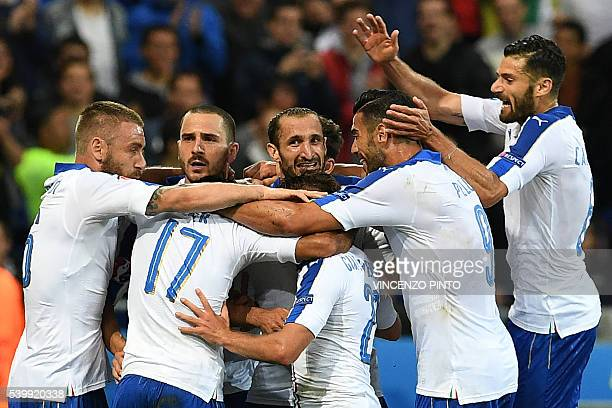 Italy's midfielder Emanuele Giaccherini celebrates with teammates after scoring during the Euro 2016 group E football match between Belgium and Italy...