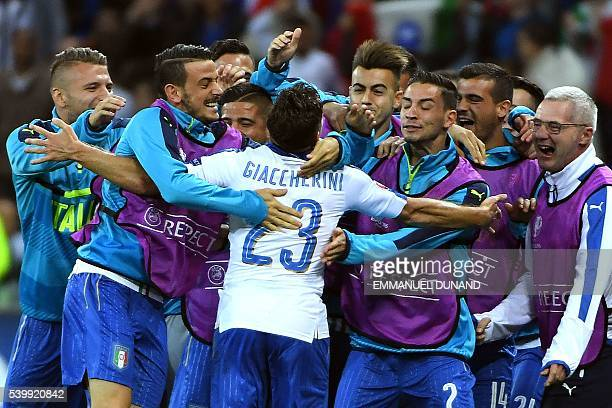 TOPSHOT Italy's midfielder Emanuele Giaccherini celebrates with teammates after scoring during the Euro 2016 group E football match between Belgium...