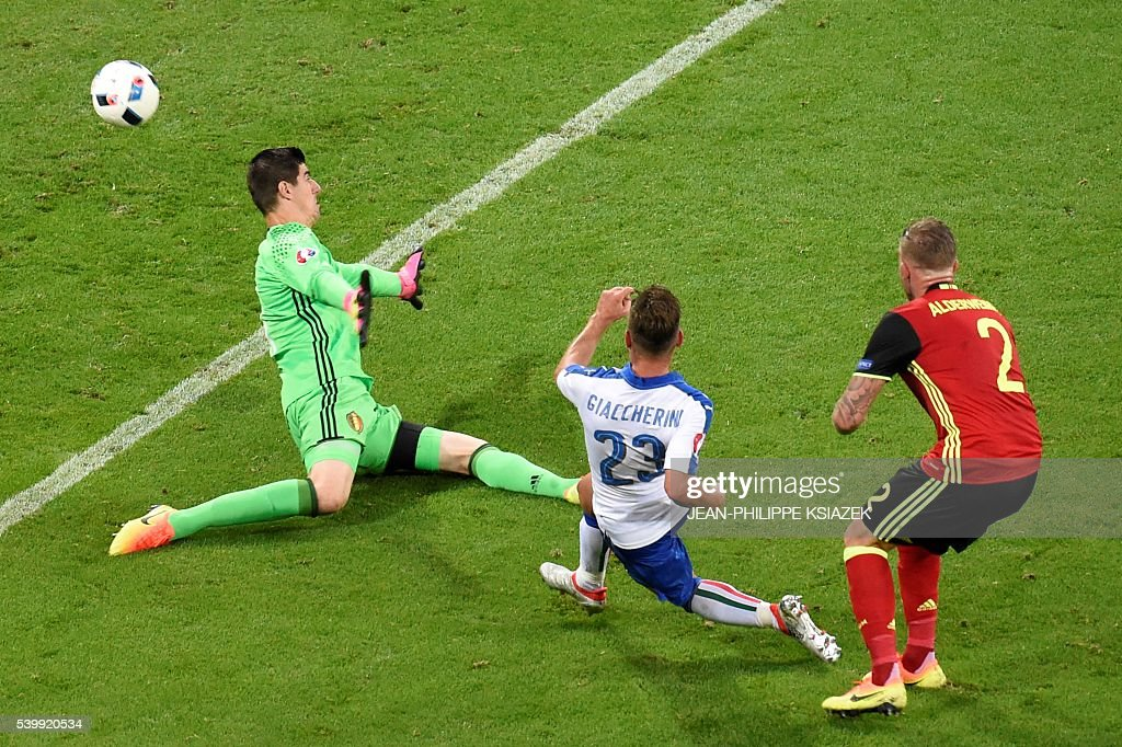 Italy's midfielder Emanuele Giaccherini shoots the team's first goal past Belgium's goalkeeper Thibaut Courtois during the Euro 2016 group E football match between Belgium and Italy at the Parc Olympique Lyonnais stadium in Lyon on June 13, 2016. / AFP / JEAN