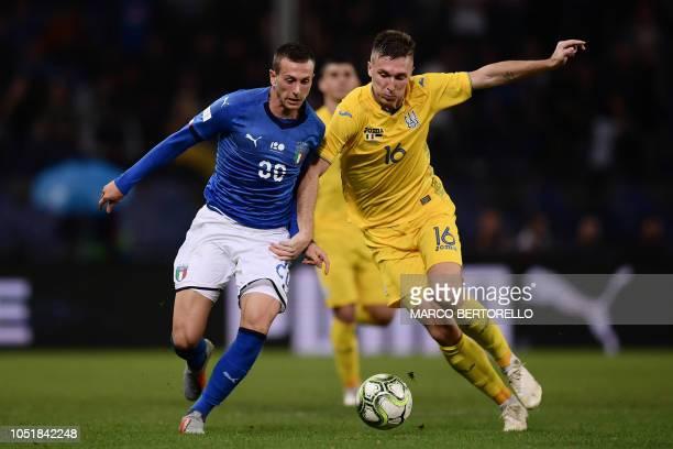 Italy's midfielder Federico Bernardeschi and Ukraine's midfielder Serhiy Sydorchuk go for the ball during the friendly football match Italy vs...