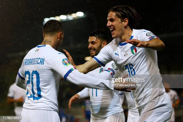 Italy's midfielder Federico Bernardeschi celebrates with teammates after scoring during the Euro 2020 Group J qualification football match between...