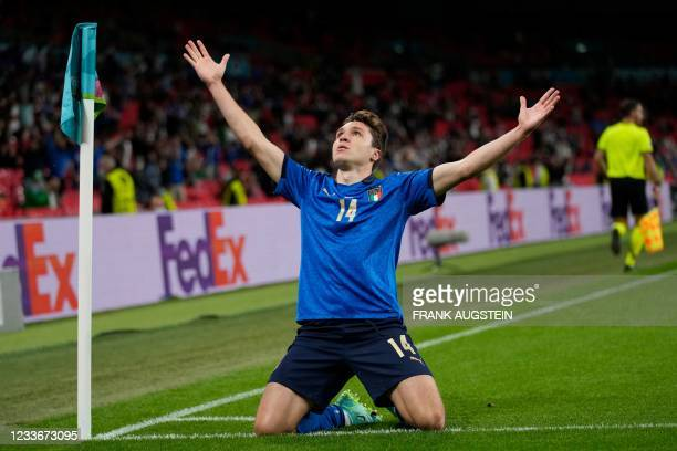 Italy's midfielder Federico Chiesa celebrates after scoring the opening goal during the UEFA EURO 2020 round of 16 football match between Italy and...