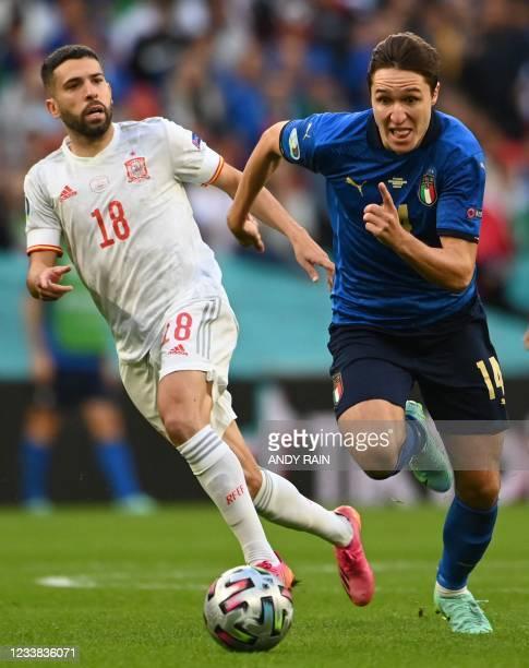 Italy's midfielder Federico Chiesa runs past Spain's defender Jordi Alba during the UEFA EURO 2020 semi-final football match between Italy and Spain...