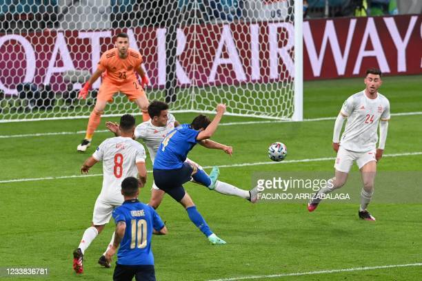 Italy's midfielder Federico Chiesa shoots and scores his team's first goal during the UEFA EURO 2020 semi-final football match between Italy and...