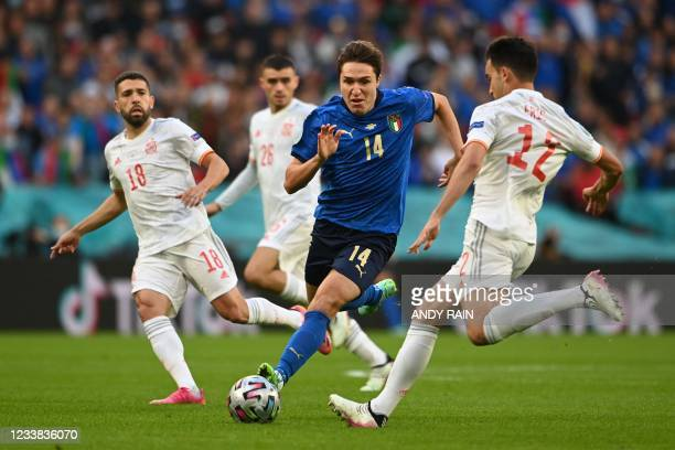 Italy's midfielder Federico Chiesa vies for the ball with Spain's defender Eric Garcia during the UEFA EURO 2020 semi-final football match between...