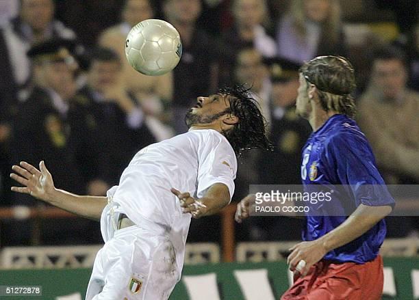 Italy's midfielder Gennaro Gattuso challenges Moldova's Stanislav Ivanov during their World Cup 2006 qualifying football match in Chisinau 08...