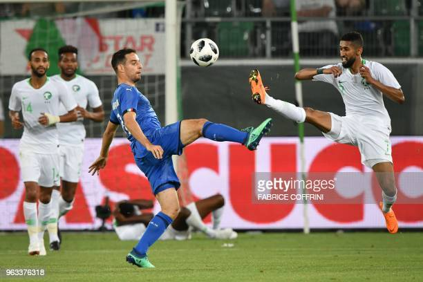 Italy's midfielder Giacomo Bonaventura and Saudi Arabia's midfielder Salman Alfaraj vie for the ball during the friendly football match between Italy...