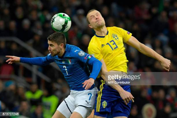 Italy's midfielder Jorginho fights for the ball with Sweden's midfielder Jakob Johansson during the FIFA World Cup 2018 qualification football match...