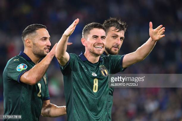 Italy's midfielder Jorginho is congratulated by Italy's defender Danilo D'Ambrosio after scoring a goal during the UEFA Euro 2020 Group J qualifier...