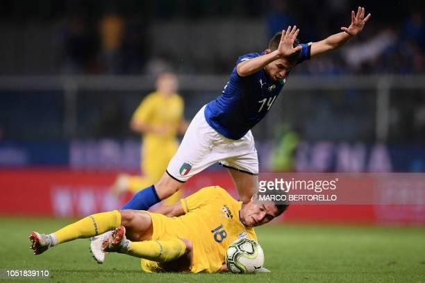 Italy's midfielder Jorginho jumps over Ukraine's forward Roman Yaremchuk during the friendly football match Italy vs Ukraine on October 10 2018 at...