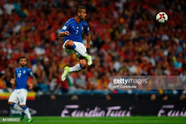 Italy's midfielder Leonardo Spinazzola eyes the ball during the World Cup 2018 qualifier football match Spain vs Italy at the Santiago Bernabeu...