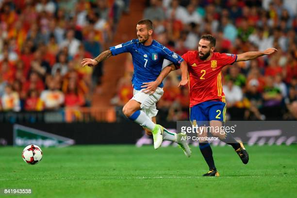 Italy's midfielder Leonardo Spinazzola vies with Spain's defender Dani Carvajal during the World Cup 2018 qualifier football match Spain vs Italy at...