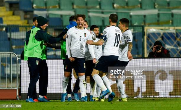 Italy's midfielder Manuel Locatelli celebrates scoring his team's second goal during the FIFA World Cup Qatar 2022 qualification football match...