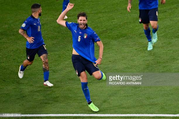 Italy's midfielder Manuel Locatelli celebrates scoring the team's first goal during the UEFA EURO 2020 Group A football match between Italy and...