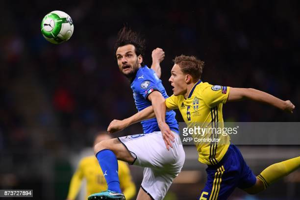 Italy's midfielder Marco Parolo fights for the ball with Sweden's defender Ludwig Augustinsson during the FIFA World Cup 2018 qualification football...
