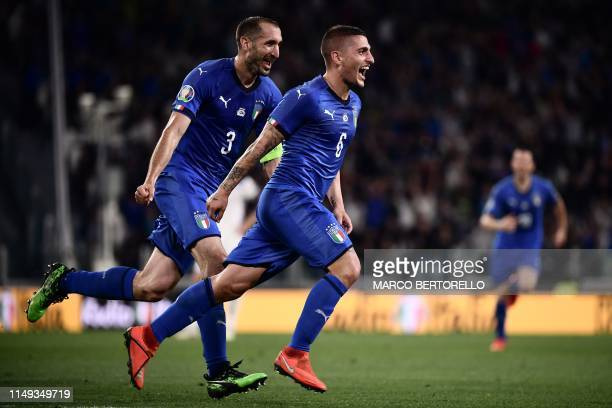 Italy's midfielder Marco Verratti celebrates with Italy's defender Giorgio Chiellini after scoring a goal during the UEFA Euro 2020 qualification...