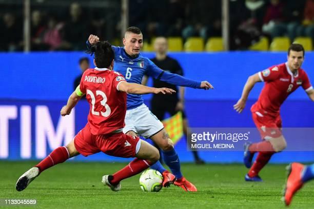 Italy's midfielder Marco Verratti challenges Liechtenstein's midfielder Michele Polverino during the Euro 2020 Group J qualifying football match...