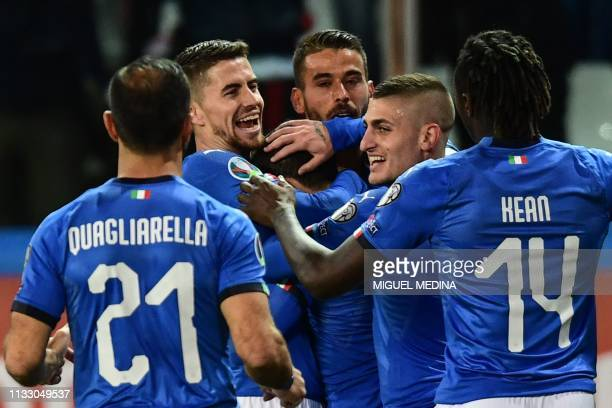 Italy's midfielder Marco Verratti congratulates Italy's midfielder Stefano Sensi after he opened the scoring during the Euro 2020 Group J qualifying...