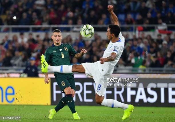 Italy's midfielder Marco Verratti fights for the ball with Greece's midfielder Carlos Zeca during the UEFA Euro 2020 Group J qualifier football match...