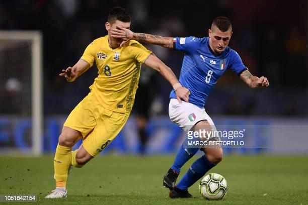 Italy's midfielder Marco Verratti hits the face of Ukraine's midfielder Ruslan Malinovskyi during the friendly football match Italy vs Ukraine on...
