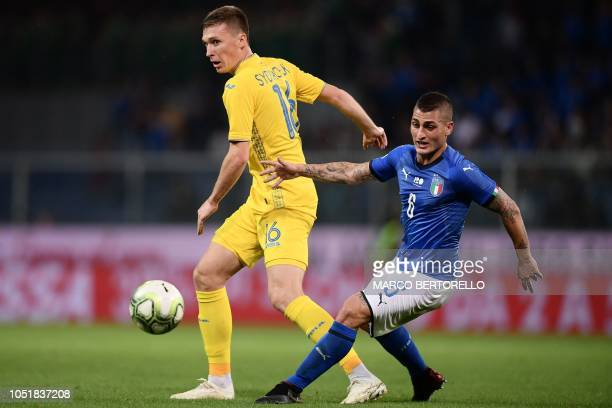 Italy's midfielder Marco Verratti passes the ball under pressure from Ukraine's midfielder Serhiy Sydorchuk during the friendly football match Italy...