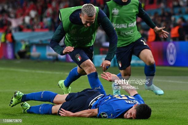 Italy's midfielder Matteo Pessina celebrates with teammates after scoring the team's second goal during extra-time in UEFA EURO 2020 round of 16...