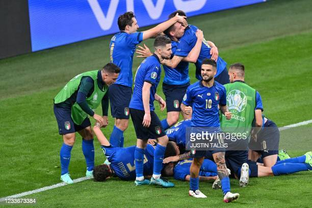 Italy's midfielder Matteo Pessina celebrates with teammates after scoring the team's second goal during extra-time in the UEFA EURO 2020 round of 16...