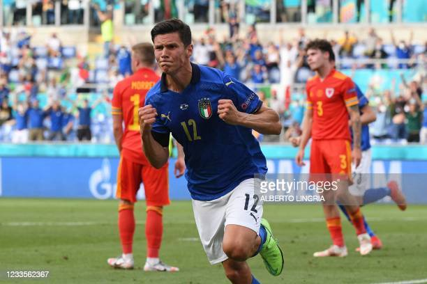 Italy's midfielder Matteo Pessina runs to celebrate the opening goal during the UEFA EURO 2020 Group A football match between Italy and Wales at the...