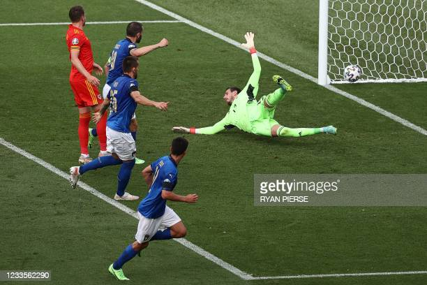 Italy's midfielder Matteo Pessina scores past Wales' goalkeeper Danny Ward during the UEFA EURO 2020 Group A football match between Italy and Wales...