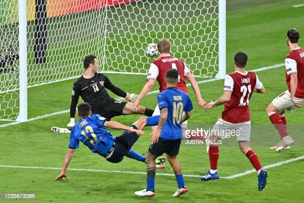 Italy's midfielder Matteo Pessina scores the team's second goal during extra-time in the UEFA EURO 2020 round of 16 football match between Italy and...