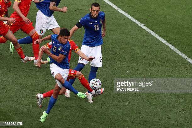 Italy's midfielder Matteo Pessina shoots the ball to score the first goal during the UEFA EURO 2020 Group A football match between Italy and Wales at...
