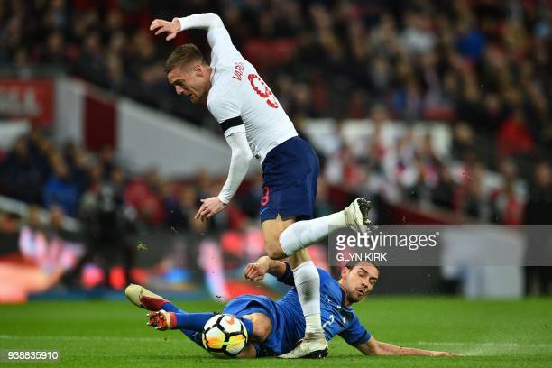 Italy's midfielder Mattia De Sciglio slides in to make a vital tackle on England's striker Jamie Vardy during the International friendly football...