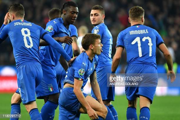Italy's midfielder Nicolo Barella celebrates after scoring during the Euro 2020 Group J qualifying football match between Italy and Finland on March...
