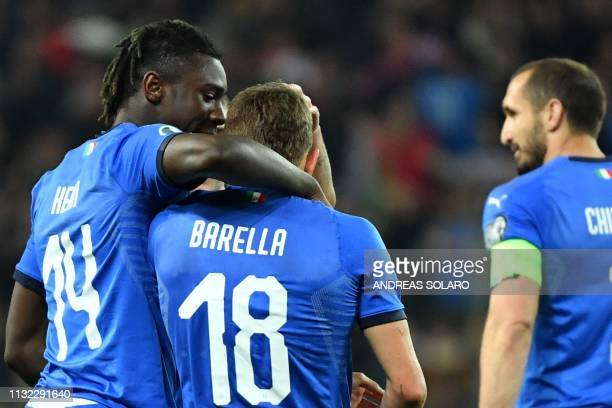 Italy's midfielder Nicolo Barella celebrates with Italy's forward Moise Kean after scoring during the Euro 2020 Group J qualifying football match...