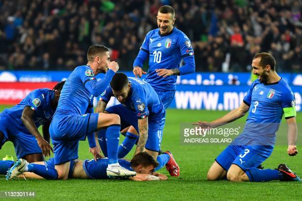 Italy's midfielder Nicolo Barella celebrates with Italy's midfielder Jorginho Italy's midfielder Federico Bernardeschi and Italy's defender Giorgio...