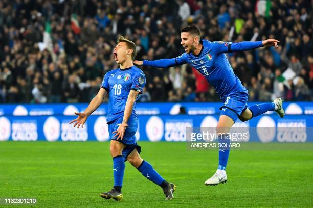 Italy's midfielder Nicolo Barella celebrates with Italy's midfielder Jorginho after scoring during the Euro 2020 Group J qualifying football match...