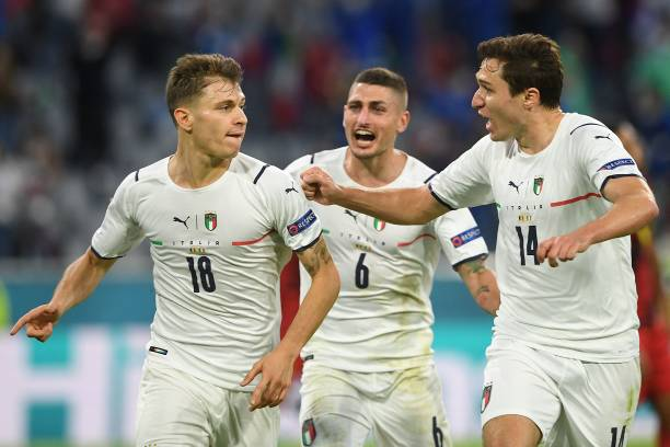 Italy's midfielder Nicolo Barella celebrates with teammates after scoring the team's first goal during the UEFA EURO 2020 quarter-final football...
