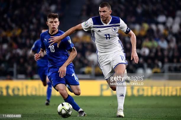 Italy's midfielder Nicolo Barella fights for the ball with BosniaHerzegovina's forward Edin Dzeko during the UEFA Euro 2020 qualification football...