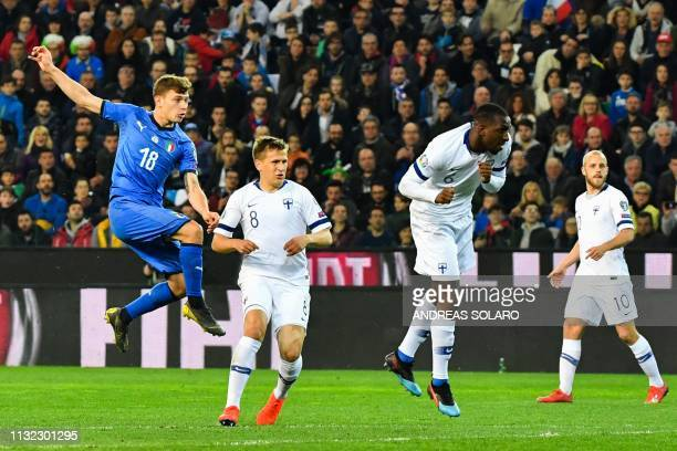 Italy's midfielder Nicolo Barella shoots to open the scoring during the Euro 2020 Group J qualifying football match between Italy and Finland on...