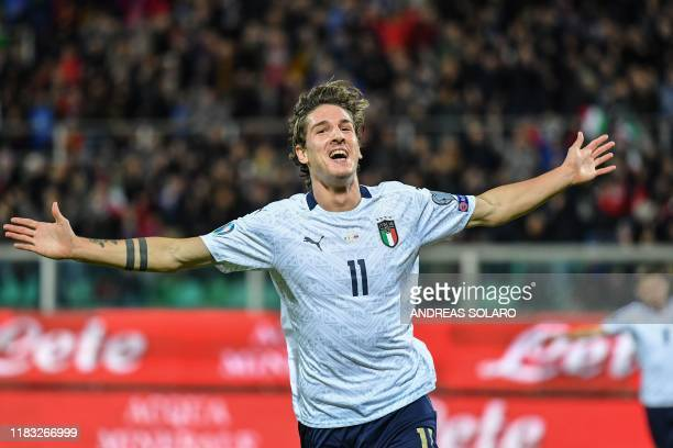 Italy's midfielder Nicolo Zaniolo celebrates after scoring during the Euro 2020 1st round Group J qualifying football match Italy v Armenia on...