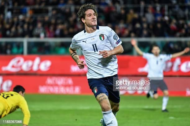 Italy's midfielder Nicolo Zaniolo celebrates after scoring during the Euro 2020 1st round Group J qualifying football match Italy v Armenia on...