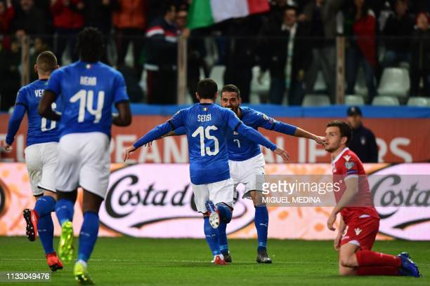 Italy's midfielder Stefano Sensi celebrates with Italy's defender Leonardo Spinazzola after scoring during the Euro 2020 Group J qualifying football...