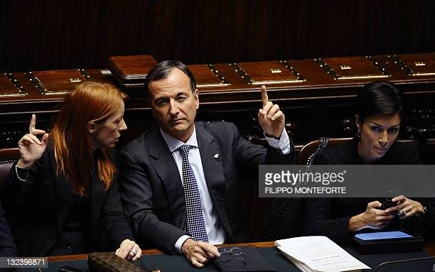 Italy's minister Michela Vittoria Brambilla foreign minister Franco Frattini and education minister Mara Carfagna react at the parliament during a...