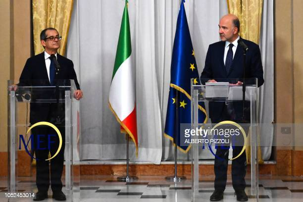 Italy's Minister of Economy and Finances Giovanni Tria and European Affairs Commissioner Pierre Moscovici hold a press conference following their...