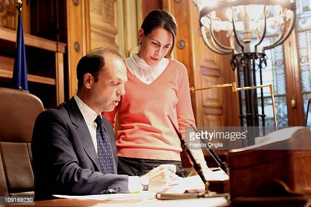 Italy's minister of Justice in the Berlusconi Cabinet Angelino Alfano flanked by a member of his staff works at his office of the Ministry of Justice...