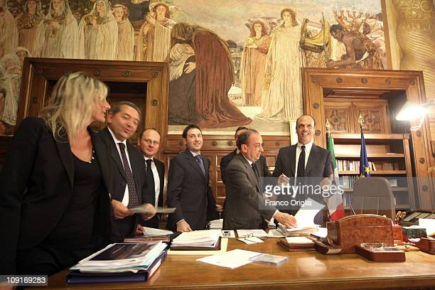 Italy's minister of Justice in the Berlusconi Cabinet Angelino Alfano flanked by members of his staff works at his office of the Ministry of Justice...